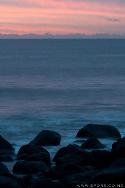 rocks waves sunset